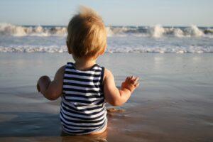 Baby wearing organic sunscreen on the beach